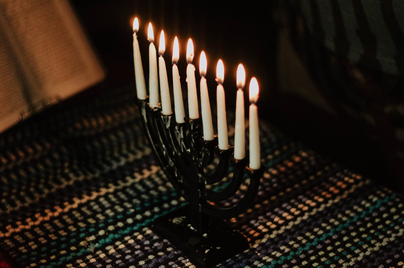 black and white menorah with lit candles