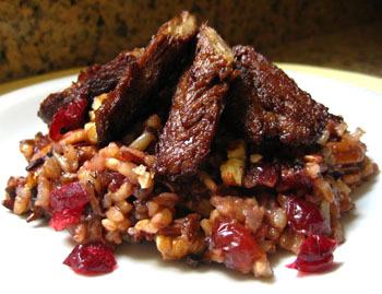 'Beef' Strips Over Pecan and Cranberry Pilaf