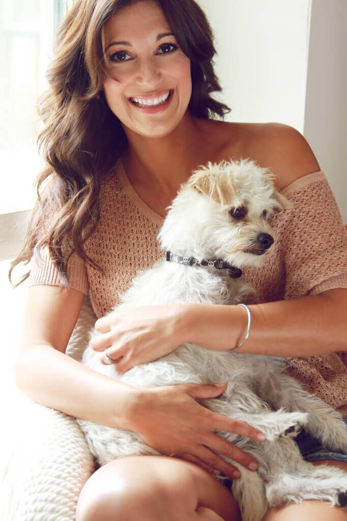Angelique Cabral poses with her dog, Oscar.