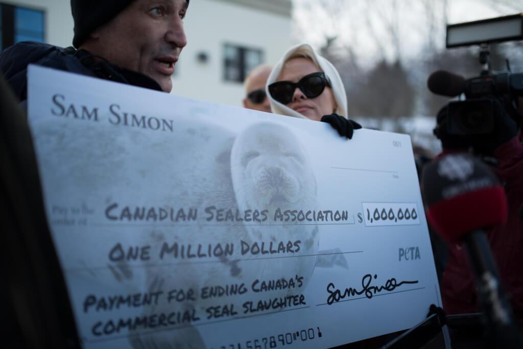 Sam Simon and Pamela Anderson with Million Dollar Check