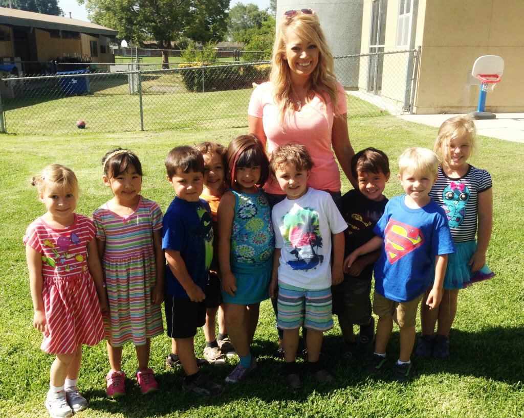 Aurora Oviedo With Some of Her Students