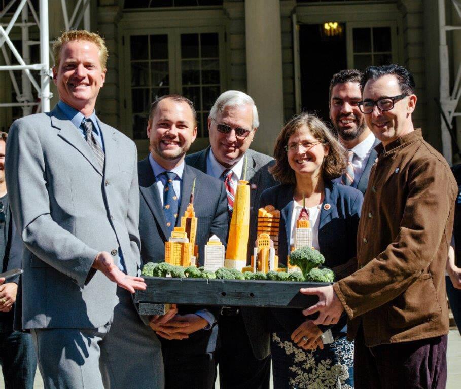 Alan Cumming and PETA's Dan Mathews Display 'Most Vegan-Friendly City' Award