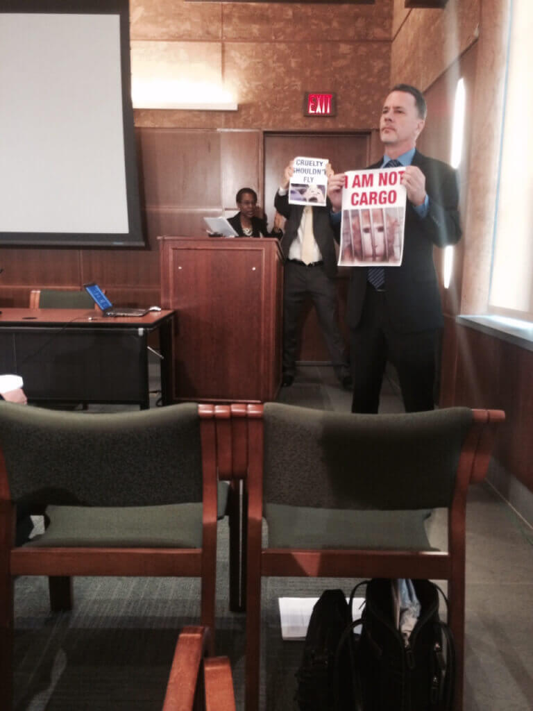 Protesters Disrupt Experimenter Meeting