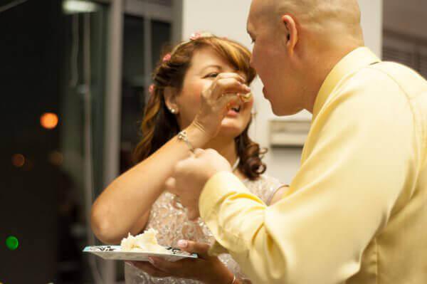 Bride Feeds Groom Cake at Sam Simon Cen