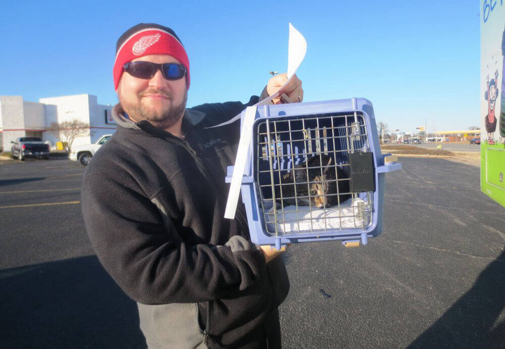 Man With Cat in Carrier