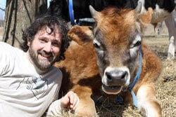 Teacher Keith Allison With Cow
