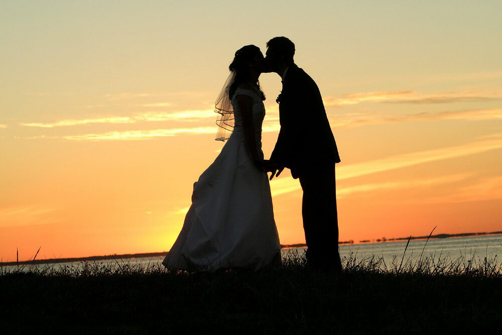 Couple in Sunset Kissing