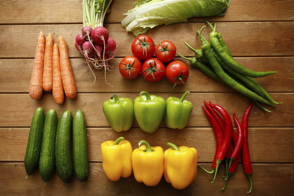 Vegan Veggies vegetables on wood