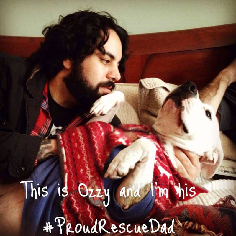 Proud-Rescue-Dad-with-Pitbull-Puppy