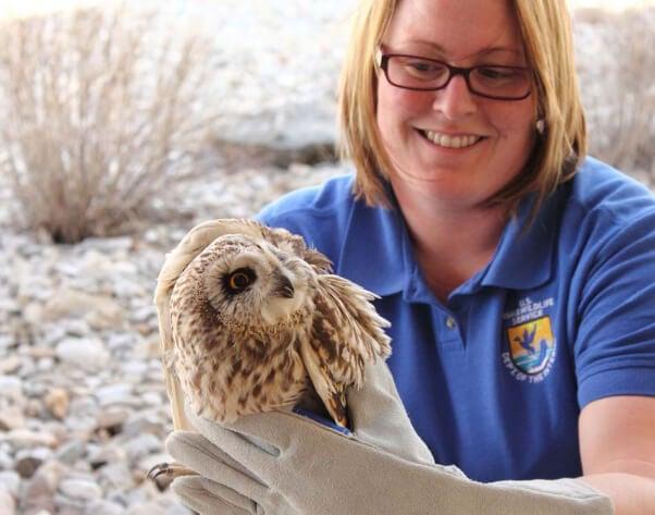 Wildlife Rehabilitator with Owl