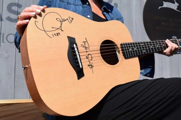 Baby Taylor guitar signed by Taylor Swift