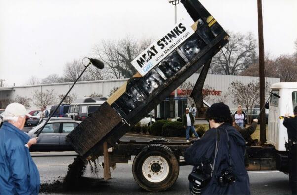 "George W. Bush ""Meat Stinks"" manure dump demo"