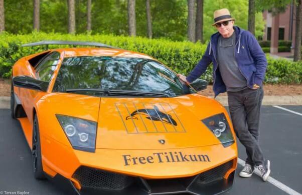 Ric O'Barry with Blackfish-themed race car car