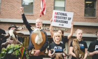 Gay PETA Vice President Leads Protest of All Gun Violence at NRA