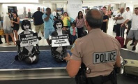 "Naked ""Orcas"" Arrested During Lolita Protest at Miami Airport"