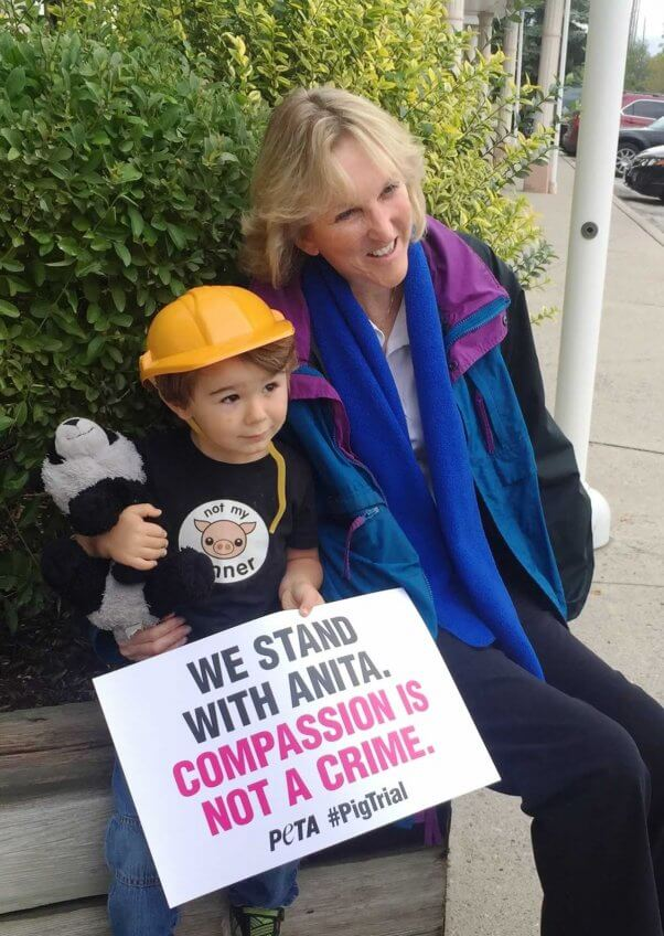 Ingrid with a young activist at Toronto Pig Save demo