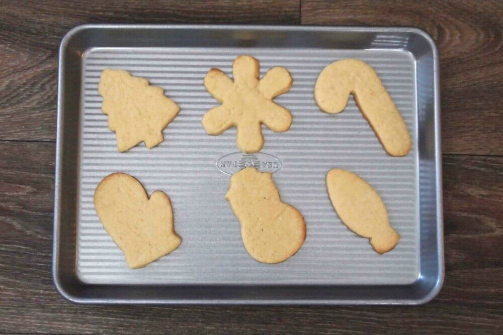 unfrosted sugar cookies in various cut out shapes on a baking sheet