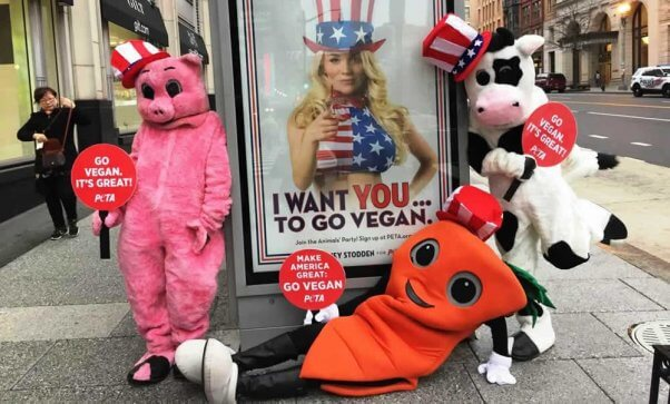 PETA mascots posing with Courtney Stodden ads in DC