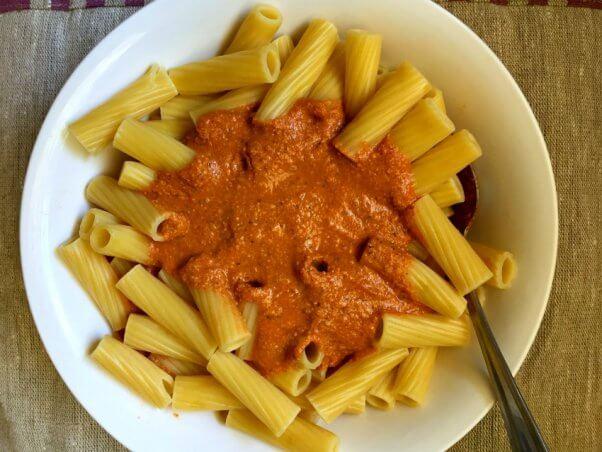 Bowl of rigatoni pasta with vegan cashew cream marina sauce