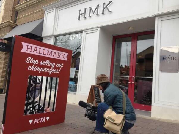 Man photographing PETA demo outside Hallmark headquarters