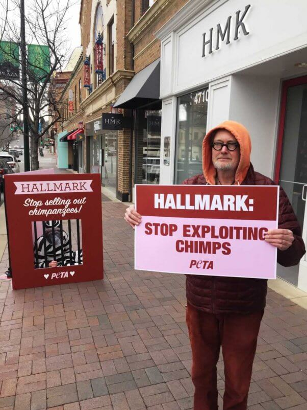 two protesters asking Hallmark to stop selling photos of exploited chimpanzees