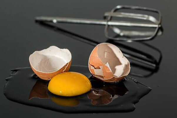 Broken or Cracked Egg with Yolk Spilling