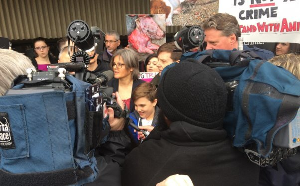 Anita speaking to a throng of reporters