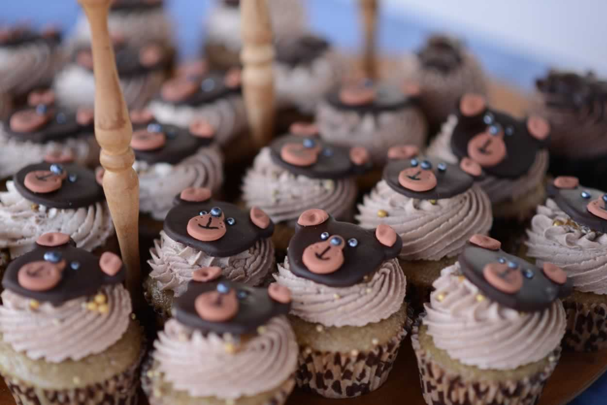 Vegan cupcakes with cute smiling bear faces on top