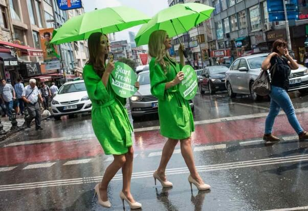 the Lettuce Ladies are a vision in green as they make their way through rainy Istanbul