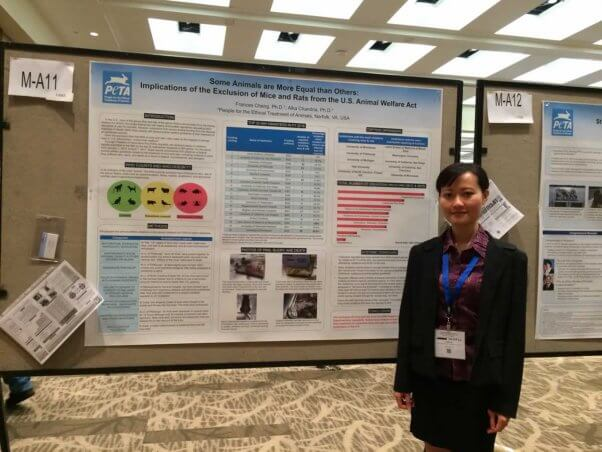 Dr. Frances Cheng in front of her poster presentation at international conference