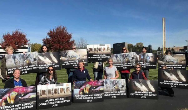 Protesters holding signs outside Patterson Vet Supply