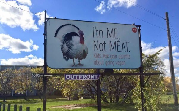 """Billboard with photo of turkey and text: """"I'm me, not meat. Kids, ask your parents about going vegan."""""""