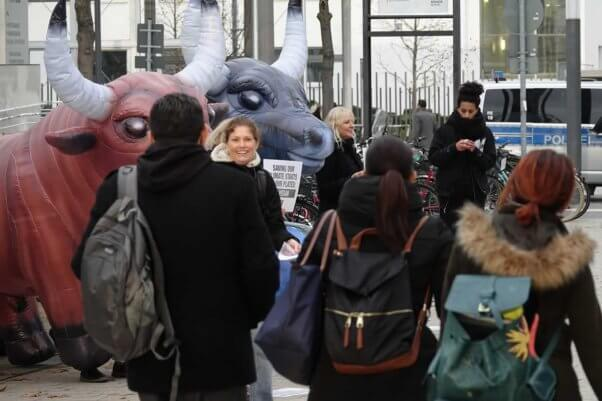 PETA supporters interacting with crowd of people