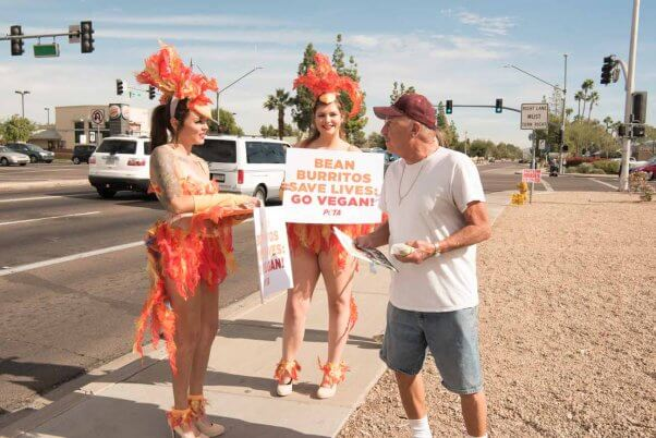 PETA activists meet with locals and hand out vegan burritos near a Taco Bell in Phoenix