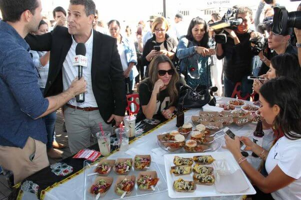 the cameras are out at PETA's vegan chilaquiles cook-off event