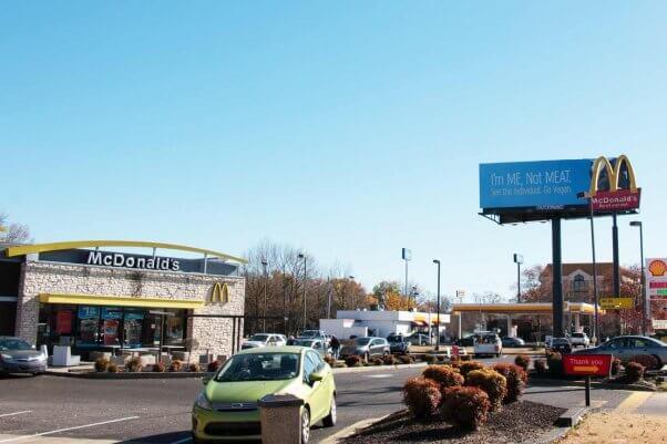 at a Memphis McDonalds, PETA's I'M ME NOT MEAT ad looms overhead
