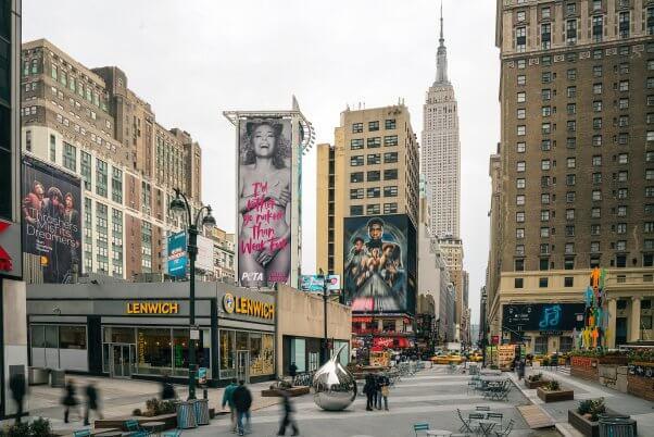 new york skyline with 70 foot billboard of nude Gillian Anderson