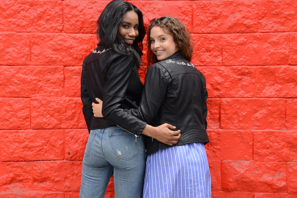 Image of two women modeling the PETA and Coalition LA faux leather jacket