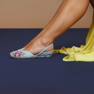 lavender embroidered slingbacks on two feet