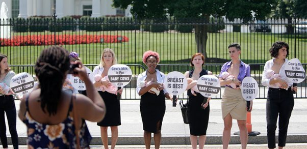 women protest outside of the white house