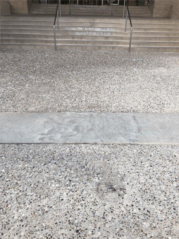texas A&M matt bruce sidewalk chalk message erased