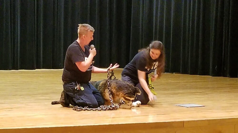 During an animal-care presentation, two PETA fieldworkers inform students about the detrimental effects of neglecting and chaining dogs.