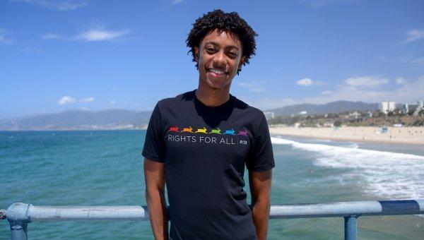 model wearing a black peta tishirt at the beach