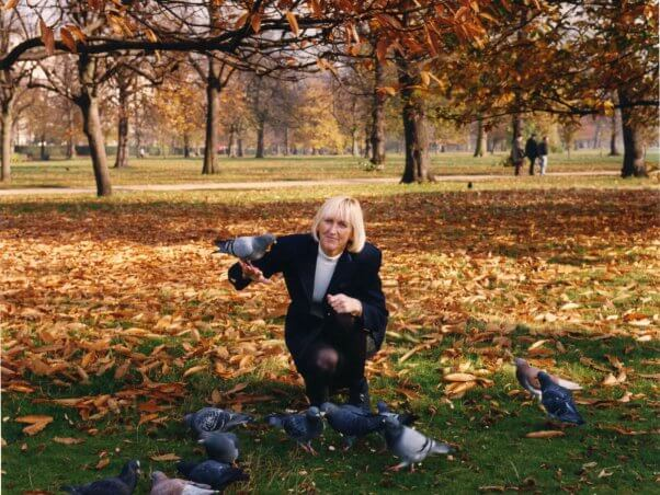 Ingrid Newkirk IEN in park with birds