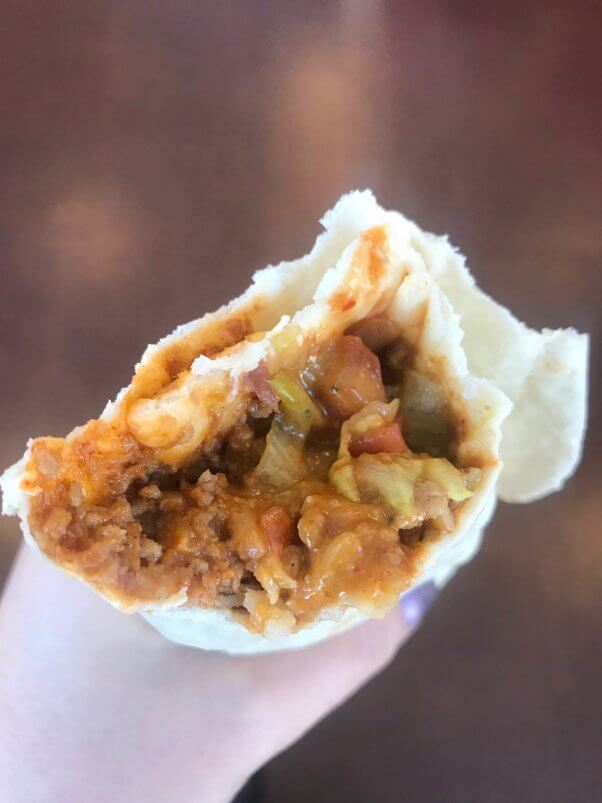 inside of beyond 8 layer veggie burrito vegan burrito from del taco