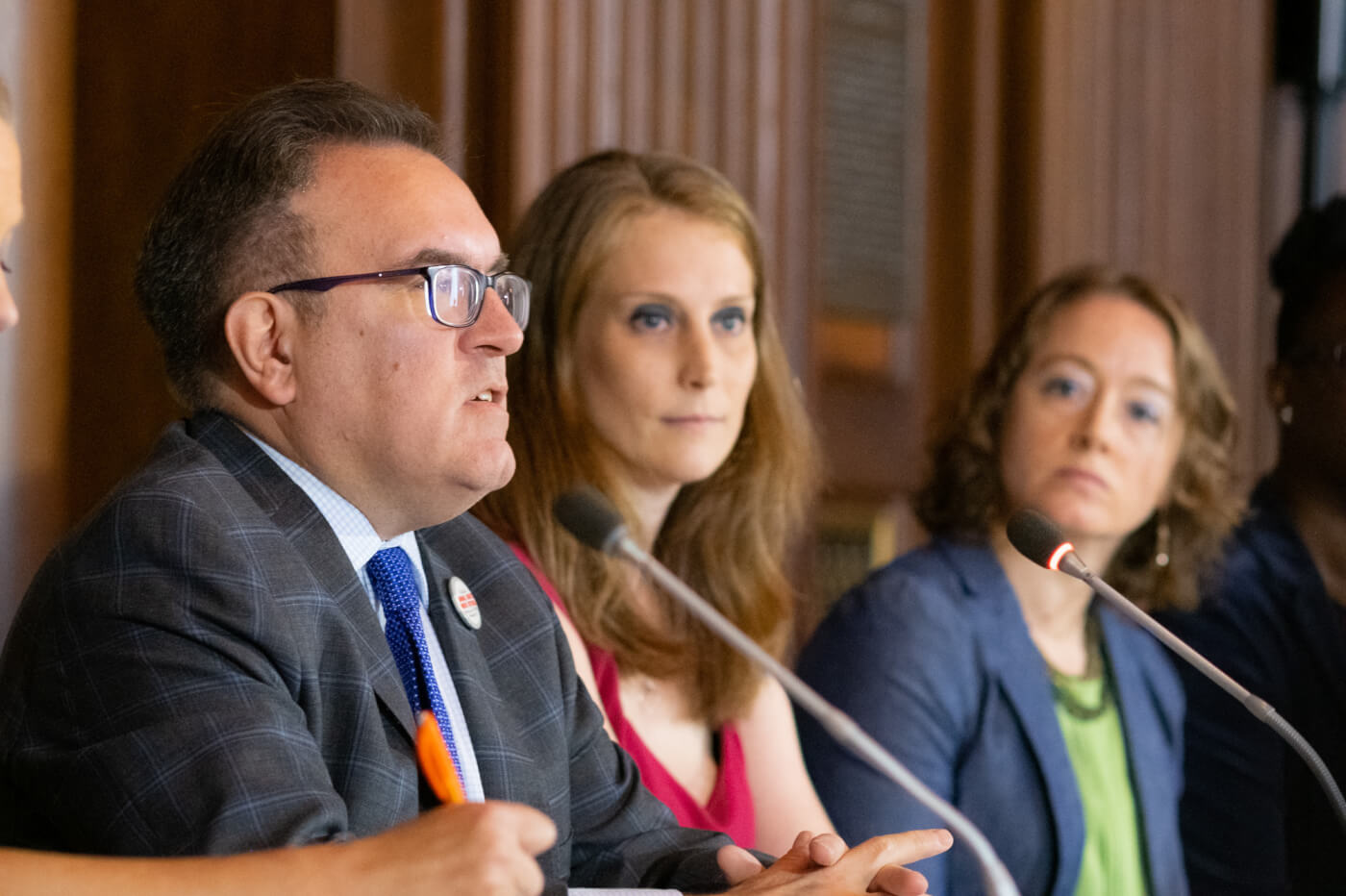 PETA scientist Dr. Amy Clippinger sits next to EPA Administrator Andrew Wheeler