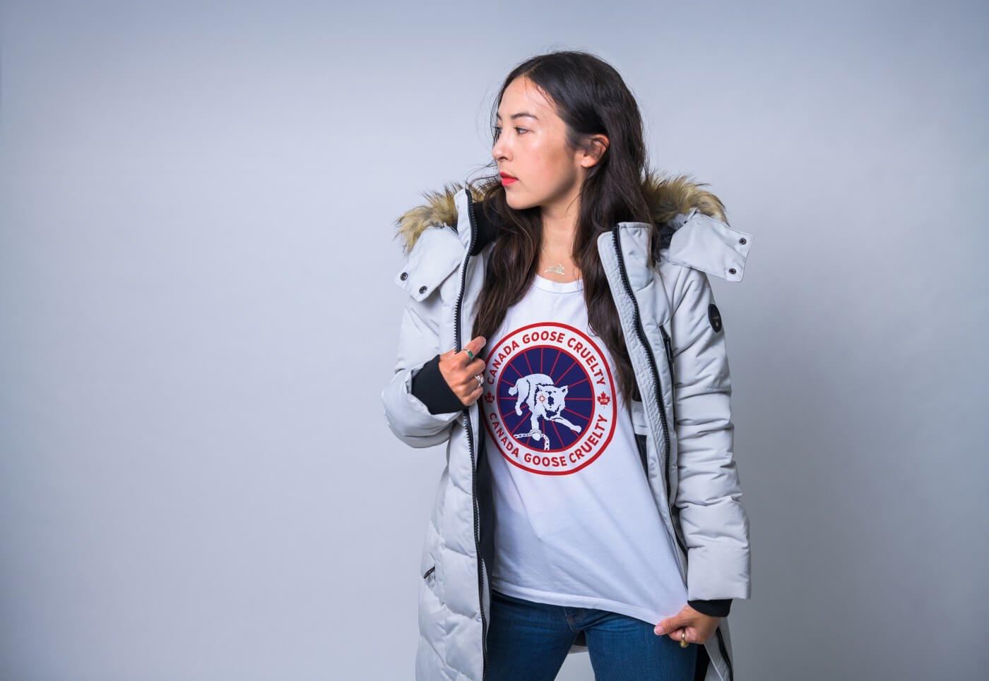 woman wearing a vegan winter coat wears a shirt protesting canada goose