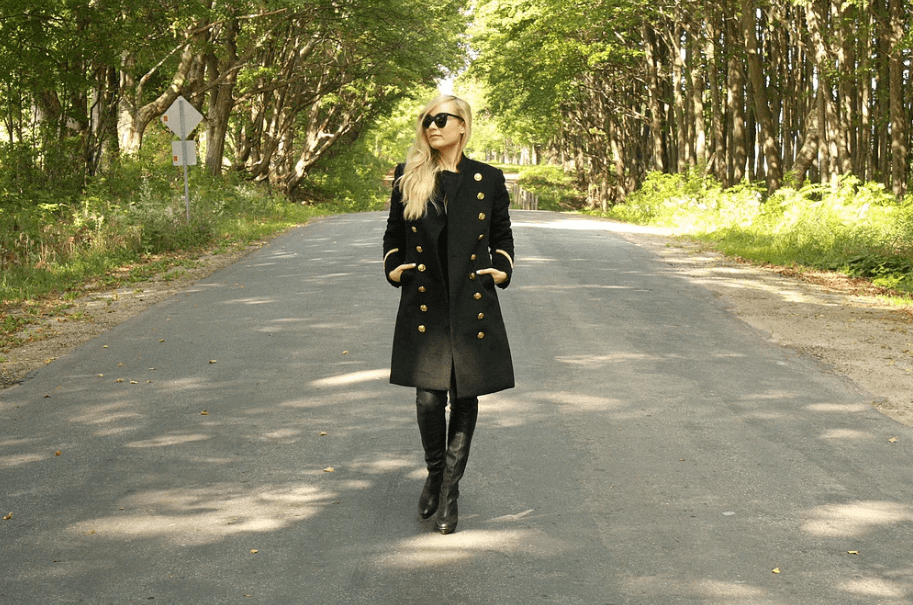Long black coat with gold buttons and trim