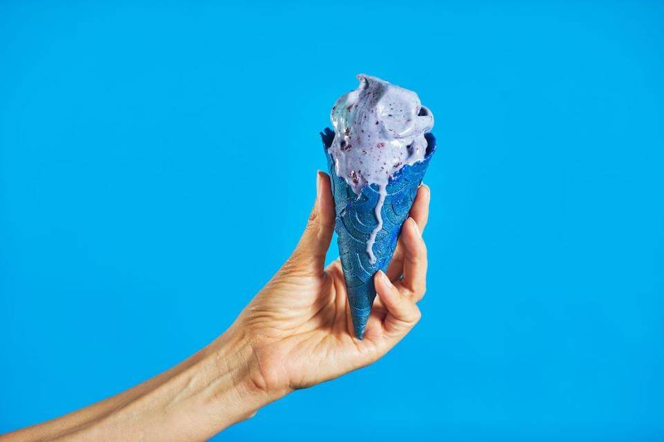 eclipse ice cream in blue cone with blue background