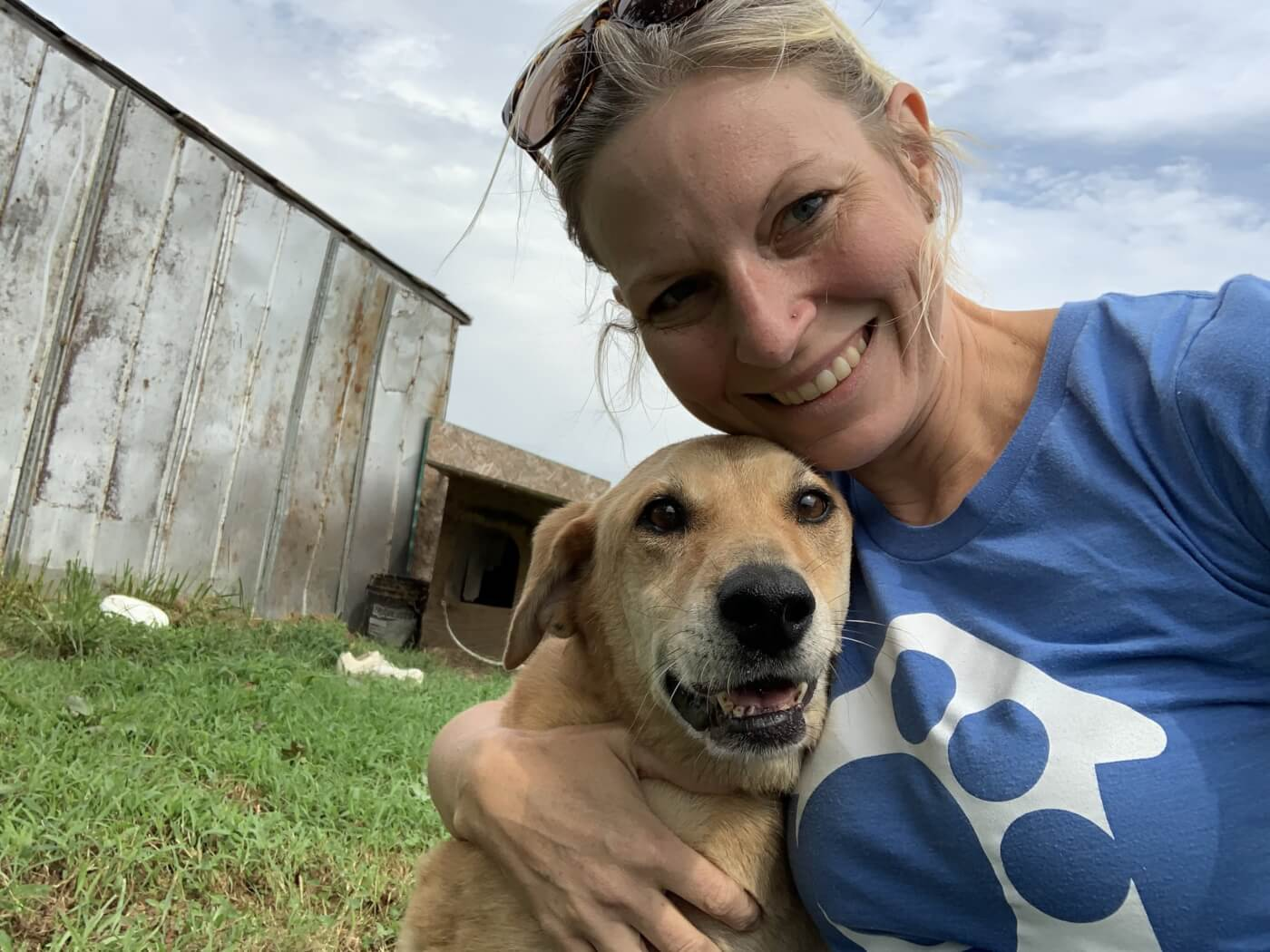 Woman posing with dog in a selfie